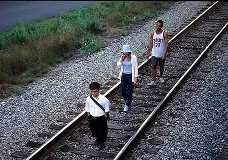 The Station Agent characters walking along the train tracks