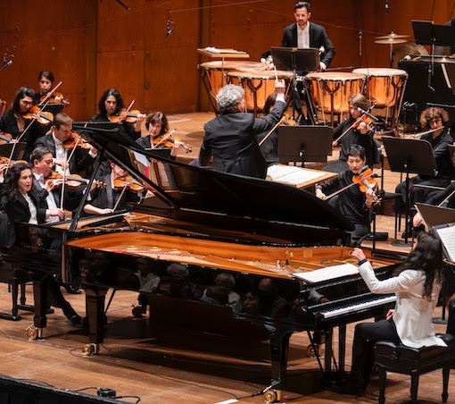 Katia and Marielle Labeque performed Bruch's Concerto for Two Pianos with Semyon Bychkov conducting the New York Philharmonic Thursday night at David Geffen Hall. Photo: Chris Lee
