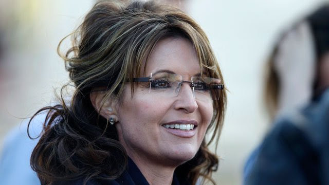 Former Alaska Gov. Sarah Palin listens to guests at a clambake in Seabrook, NH, Thursday, June 2, 2011. Palin has been visiting East coast cities this past week. (AP Photo/Charles Krupa)