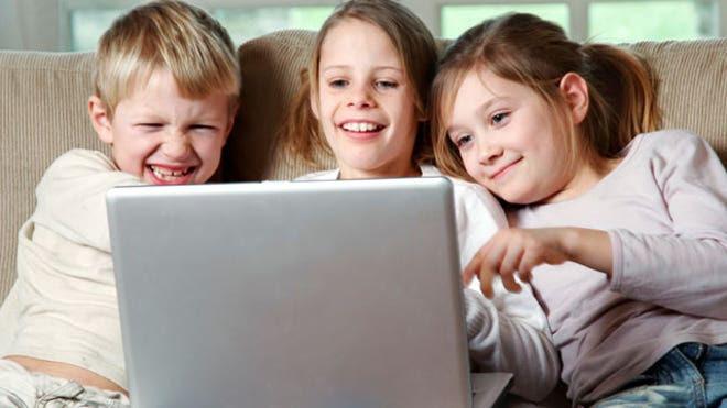 Kids on a Laptop Computer Having Fun