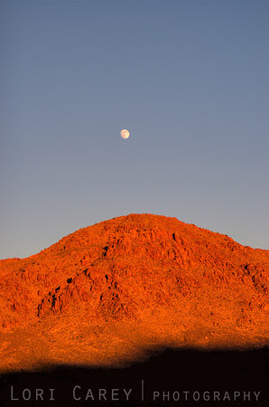 Mmoonrise over Ivanpah Mountains in the Mojave Desert, California, USA