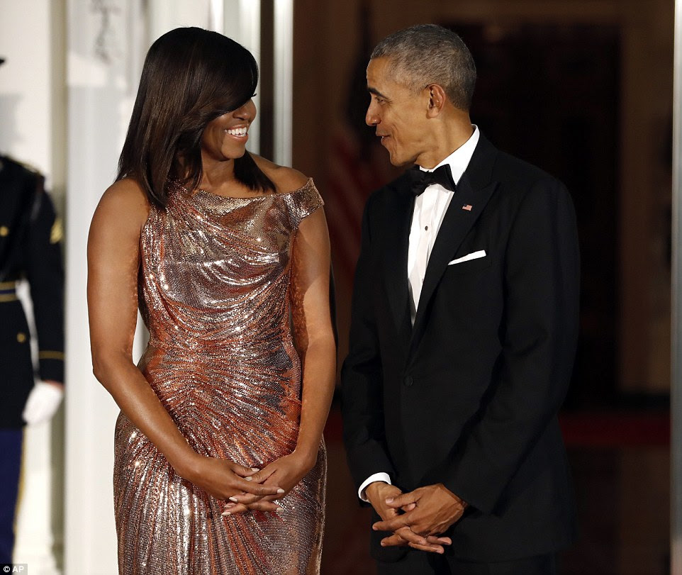 Michelle Obama looked stunning in an Atelier Versace chainmail rose gold dress next to President Obama who looked dashing in his tux