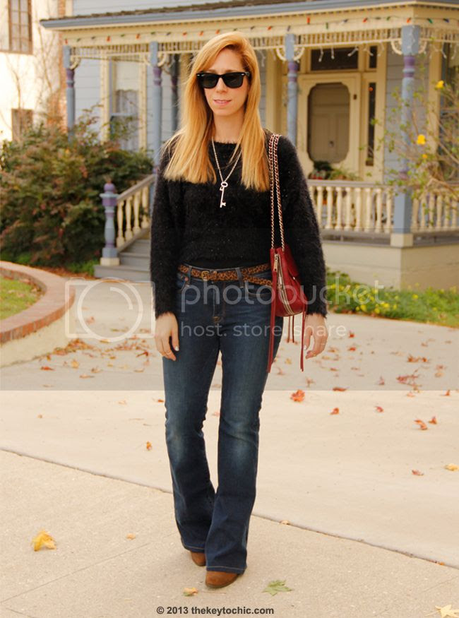LA fashion blogger The Key To Chic wears a fuzzy Boohoo sweater with Charlotte flare Lucky Brand jeans and a Rebecca Minkoff Swing bag