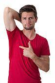 man looking at his armpit
