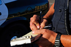 Photo: police man writing a ticket