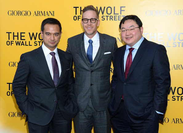 Riza Aziz, Joey Macfarland and Jho Low pose at the launch of Wolf Of Wall Street
