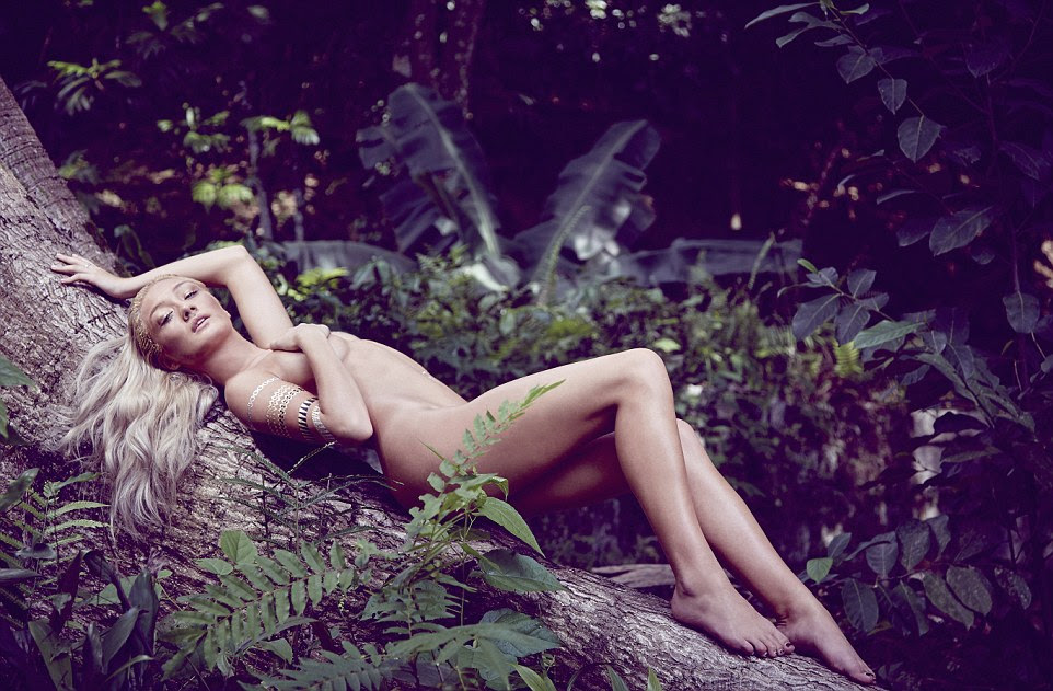 Lying on her back on the roots of a tree, Gigi Hadid-lookalike Bethan Sowerby threw one arm behind her head and strategically crossed her legs to attain her modesty