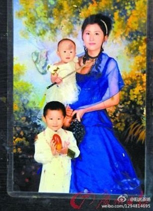 Child victim: Yuyue is held by her mother. Her older brother is also pictured