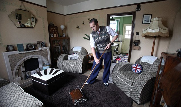 Clean sweep: Ben uses his 80-year-old Ewbank to keep his superbly authentic lounge looking Forties-perfect