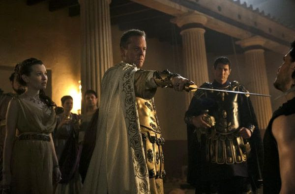 As Cassia (Emily Browning) looks on, Corvus (Kiefer Sutherland) confronts Milo (Kit Harington) in POMPEII.