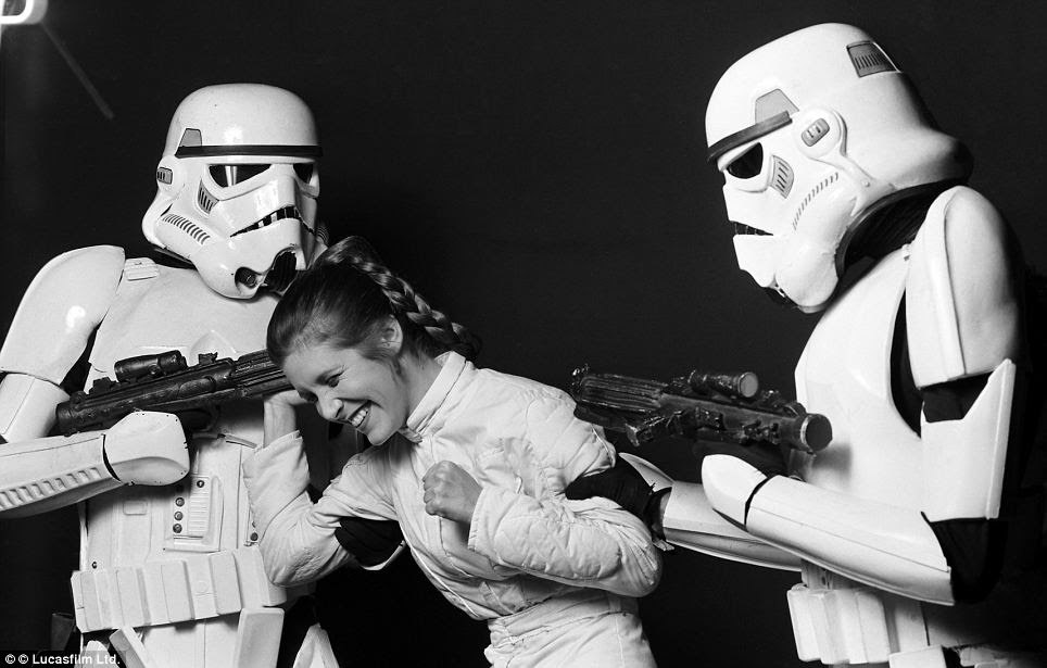 Surrender? I can't stop giggling: Carrie Fisher as Princess Leia having a fit of the giggles surrounding by two fearsome Stormtroopers