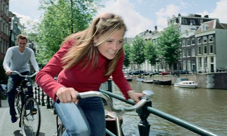 Cycling beside an Amsterdam canal