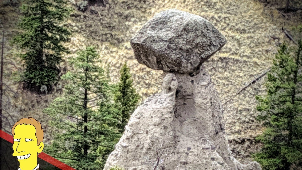 giant stone boulder balancing on clay hoodoo in Kamloops BC