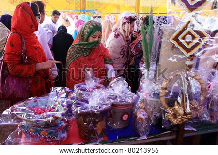 Nowshera, Pakistan - Jun 29: Women Look At Home Decoration Items ...