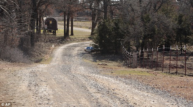 Long and winding road: A mile-long gravel drive leads to Sarah McKinley's home in Blanchard, Oklahoma