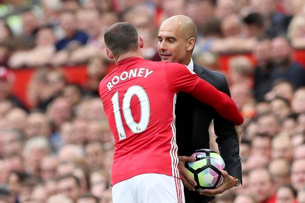 Manchester United's Wayne RooneyManchester City's Pep Guardiola clash on the touchline