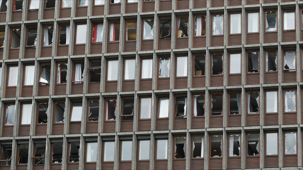 Shattered windows in a multi-storey building after the blast in Oslo, 22 July
