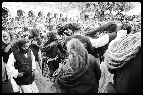 The Malangs Open Out Their Long Hair At The Holy Shrine of Zinda Shah Madar by firoze shakir photographerno1