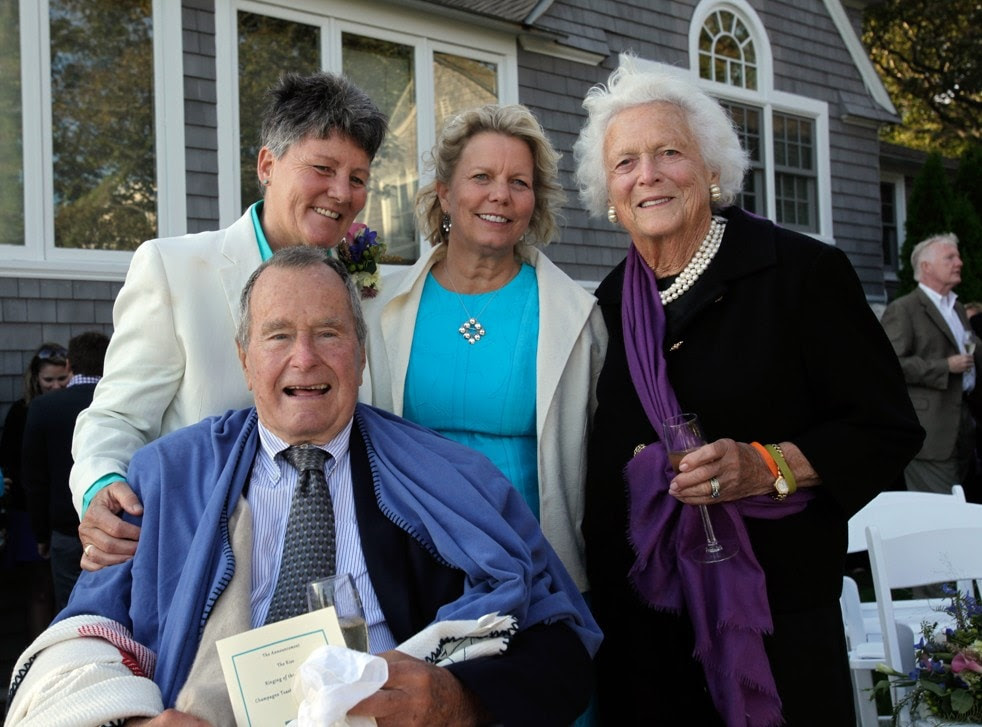 Bonnie Clement, left, and Helen Thorgalsen, center, with Barbara Bush, right, and former President George H.W. Bush, seated. (Photo by Susan Biddle)