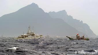 A Taiwan fishing boat (R) is blocked by a Japan Coast Guard (L) vessel near the disputed Diaoyu / Senkaku islands in the East China Sea on September 25, 2012. Coastguard vessels from Japan and Taiwan duelled with water cannon after dozens of Taiwanese boats escorted by patrol ships sailed into waters around Tokyo-controlled islands. Japanese coastguard ships sprayed water at the fishing vessels, footage on national broadcaster NHK showed, with the Taiwanese patrol boats directing their own high-pressure hoses at the Japanese ships. AFP PHOTO / Sam Yeh (Photo credit should read SAM YEH/AFP/GettyImages)