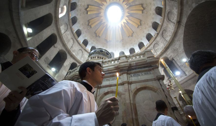 Christian pilgrims light candles during the Easter Sunday procession at the Church of the Holy Sepulchre, traditionally believed by many Christians to be the site of the crucifixion and burial of Jesus Christ, in Jerusalem, Sunday, April 16, 2017. Millions of Christians around the world are celebrating Easter commemorating the day when according to Christian tradition Jesus was resurrected in Jerusalem. (AP Photo/Sebastian Scheiner)