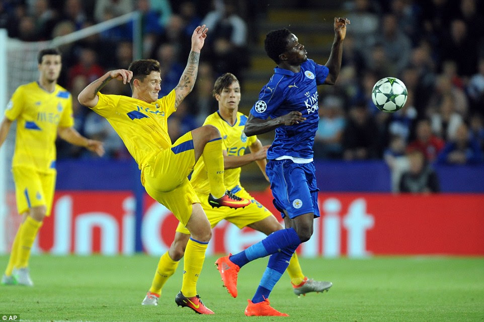 Porto forward Octavio goes through the back of Daniel Amartey during a game that produced several yellow cards