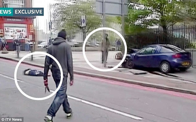 Savagery: One attacker with cleaver (circled) in hand walks towards his accomplice (also circled) as their victim lies in the road