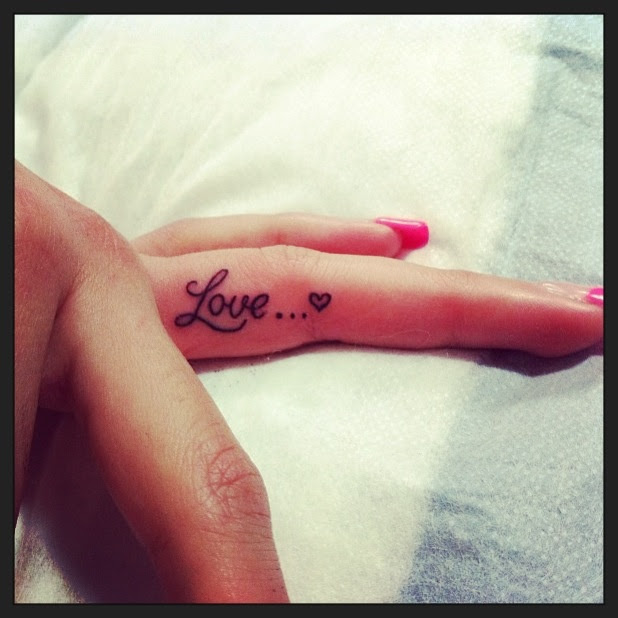 http://tattoomagz.com/wp-content/uploads/2014/04/finger-tattoo-love.jpg