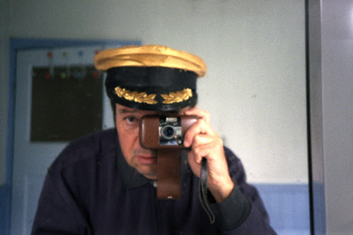 reflected self-portrait with Olympus LT-1 camera and gold cap by pho-Tony