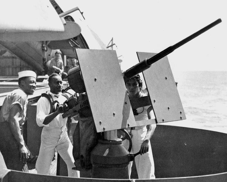 African-American mess attendants of USS Copahee posing with the ship's 20mm Oerlikon cannon, 9 Sep 1942