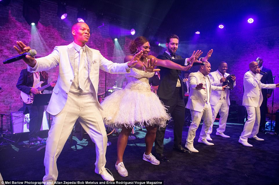 Busting a move: The bride and groom took to the stage to dance alongside New Edition, who performed some of their greatest hits