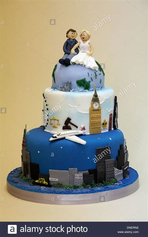 wedding cake with couple sitting on globe travelling the