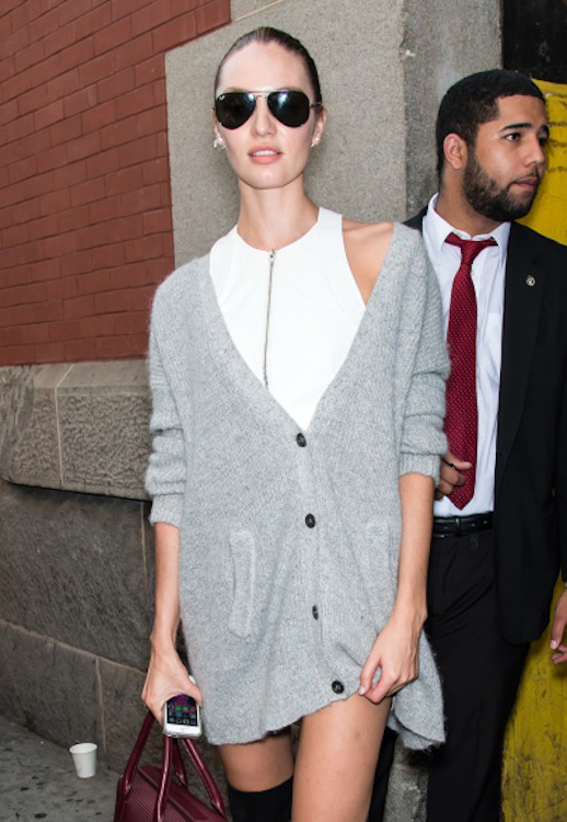Le Fashion Blog -- Candice Swanepoel in aviators, an Alexander Wang zip-front white top and an oversized cardigan -- Model Off Duty Street Style NYFW -- photo Le-Fashion-Blog-Candice-Swanepoel-Oversized-Cardigan-Model-Off-Duty-Street-Style-NYFW.png