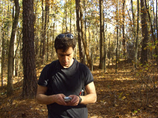 Peter texting in the woods.JPG