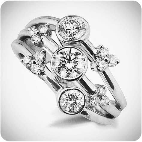 Beautiful three stone Raindance inspired ring with small