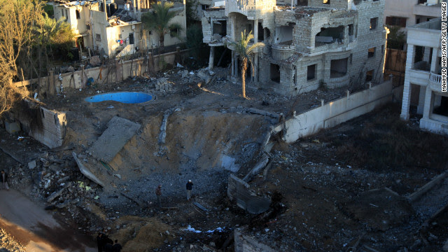 A crater is left at a spot targeted by an Israeli airstrike in Gaza City early Thursday.