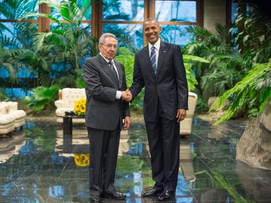 Cuban President Raul Castro and President Obama hold