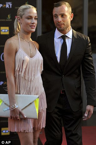 Pistorius, 29, was convicted of manslaughter for shooting Steenkamp (pictured together) through a toilet door in his home early on Valentine's Day 2013