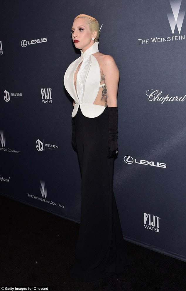 Stylish guest: The singer, whose real name is Stefani Germanotta, showed off an ample amount of flesh in the cut-out ensemble