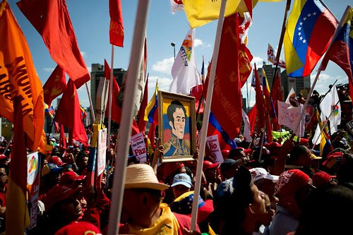 Bolivarian Venezuelan Revolution supporters march through the streets of the capital of Caracas on February 18, 2014. United States imperialism is supporting an attempted counter-revolutionary rebellion. by Pan-African News Wire File Photos