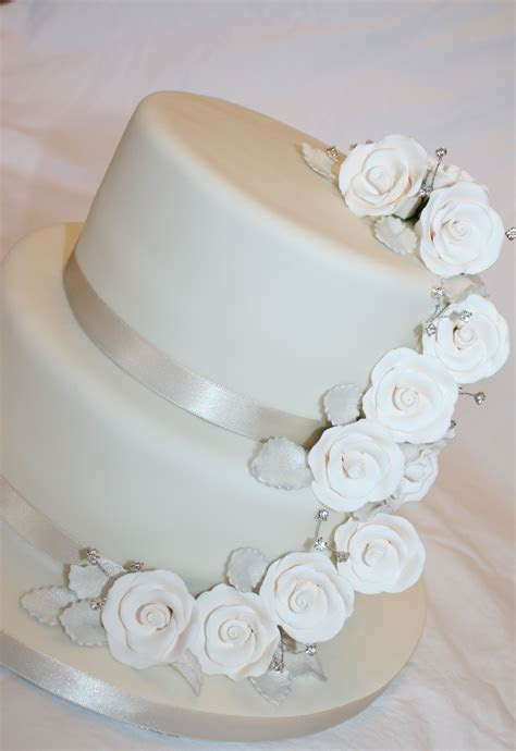 Simple wedding cake on a budget   with pre made flowers