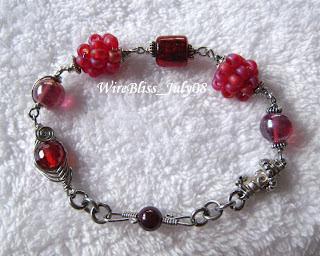 Wire wrapped cherries Bracelet with herringbone weave bead