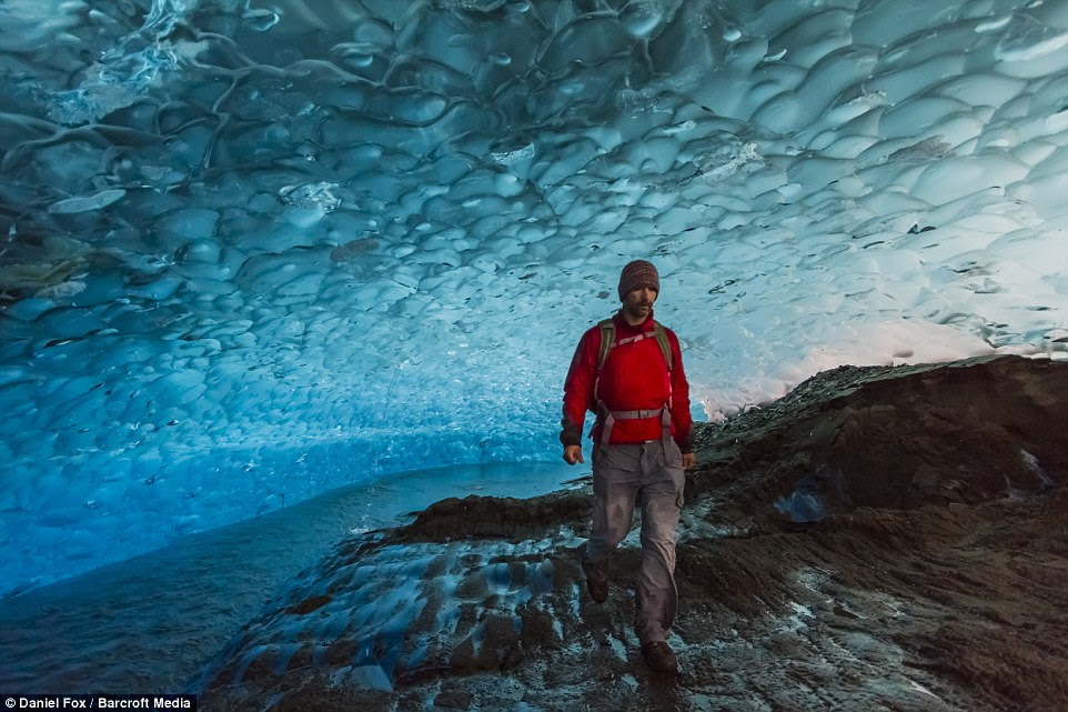 This mesmerising picture shows explorer Mr Fox inside strolling through the famous Mendenhall Glacier in Juneau Alaska