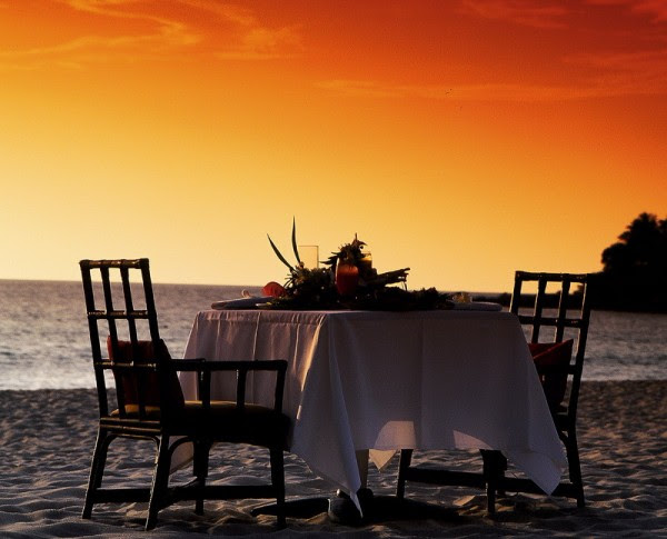 dinner on the beach under an orange sky