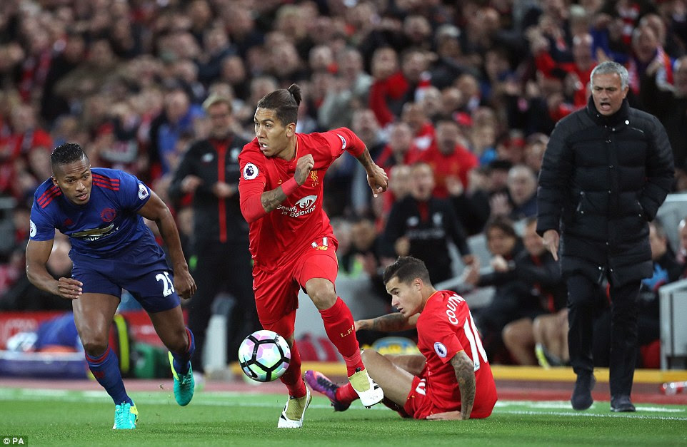 Roberto Firmino tries to escape the attention of United full back Valencia with a floored Coutinho and Mourinho watching on