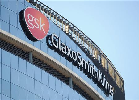 A GlaxoSmithKline logo is seen outside one of its buildings in west London in this February 6, 2008 file photograph. GlaxoSmithKline Plc has agreed to plead guilty to criminal charges and pay $3 billion to settle the largest case of healthcare fraud in U.S. history, according to court filings and prosecutors. The settlement includes $1 billion in criminal fines and $2 billion in civil fines in connection with the sale of the drug company's Paxil, Wellbutrin and Avandia products. REUTERS/Toby Melville/Files