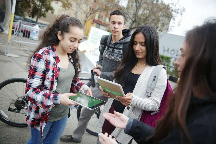 Melissa Iglesias (l to r), 15; Abel Regalado, 16; and Vanessa Martinez, 15, all students at ARISE High School register at the XQ roadshow on Wednesday, December 9,  2015 in Oakland, Calif. Photo: Lea Suzuki, The Chronicle