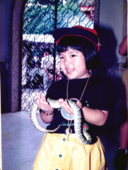 Little Sister Carrying A Snake.