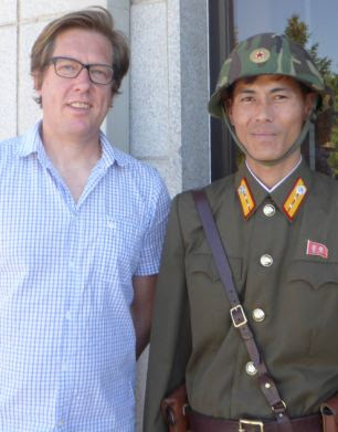 Special report: Ian Birrell (left) stands next to a North Korean soldier (right) in Pyongyang