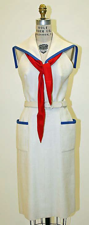 White linen sailor dress with blue trim and red silk scarf, by Norman Norell for Traina-Norell, American, 1954.